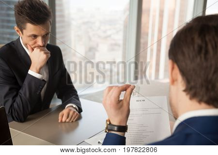 Worried unhired job applicant feeling nervous while employer or recruiter reviewing bad resume, unprepared vacancy candidate waiting for result, afraid to fail employment interview and be rejected