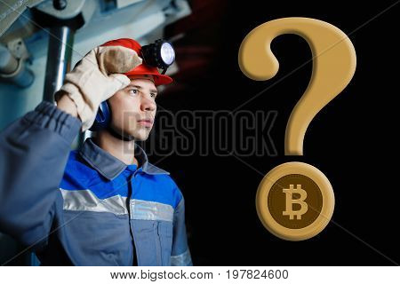 male miner on a dark background in a mine with a question mark and bitcoin. The concept of extraction of crypto currency digging mining. copyspace
