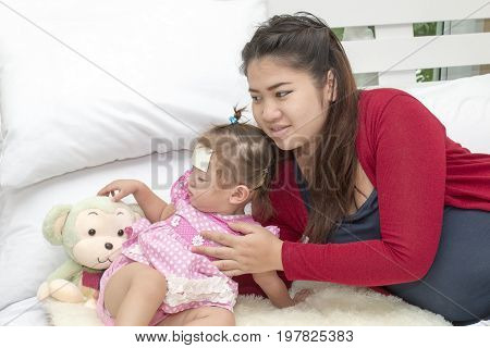 Young Pregnant Woman Seeing Her Beloved Little Daughter Taking A Nap On The Bedroom, The Baby Having