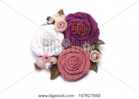 Brooch handmade consisting from of white pink and lilac flowers making from cloth