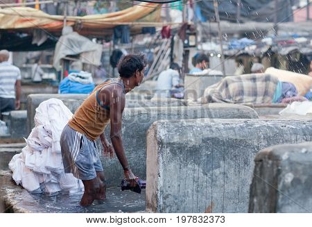 Workers Washing Clothes At Dhobi Ghat In Mumbai, Maharashtra, India
