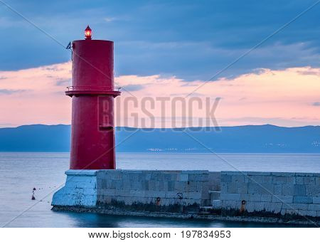 Sunset at the red lighthouse in Cres (Croatia)