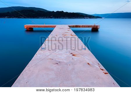 Long exposure of a jetty taken during the blue hour