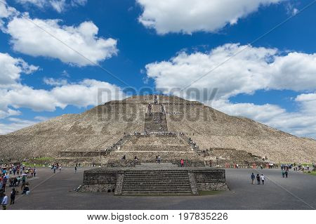 Teotihuacan State of Mexico Mexico - June 1 2014: People at the Temple of the Sun in the Teotihuacan archaeological site in Mexico. Teotihuacan was one of the largest cities in the pre-Columbian Americas.
