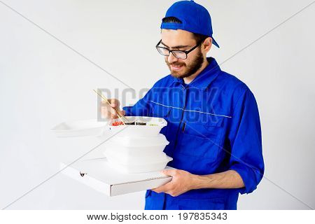 Sushi delivery service concept: delivery guy bringing sushi