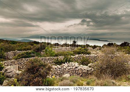 Stone walls near Grmov and Osor islands Losijn Zeca and Unije in background