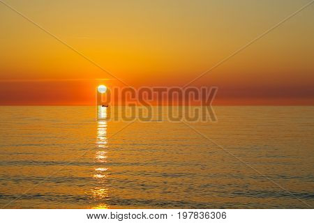 A shining evening landscape during the sunset over the Baltic Sea in a kolobrzeg in Poland