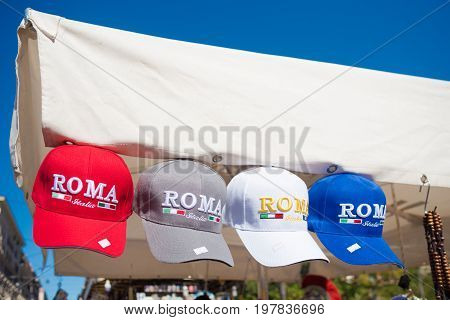 ROMA ITALY - OCTOBER 16 2016: souvenir shop with roma caps in different colors