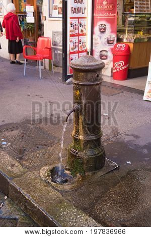 ROME ITALY - OCTOBER 16 2016: Old tap with drinking water in the city center