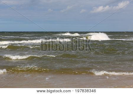 The waves on a surface of the Baltic Sea as seen at the shore of a sandy beach in Kolobrzeg in Poland