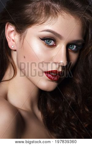 Close up portrait of beautiful young model with professional makeup, perfect skin. Trendy eyelines and red lips. Hollywood star style