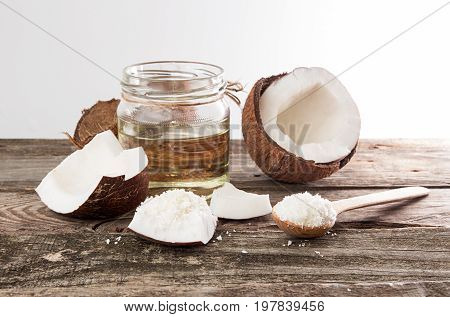 Half Of Coconut, Pieces Of Coconut, Coconut Flakes And Coconut Glaas Jar