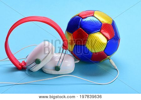Headset For Music Placed On Ball. Headphones In White, Red