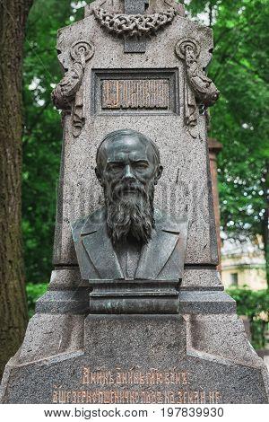 Dostoyevsky's grave at the Tikhvin cemetery. Grave of the Russian Russian novelist writer essayist journalist and philosopher Fyodor Mikhailovich Dostoyevsky in St. Petersburg. Necropolis of Alexander Nevsky Lavra. August 22 2017