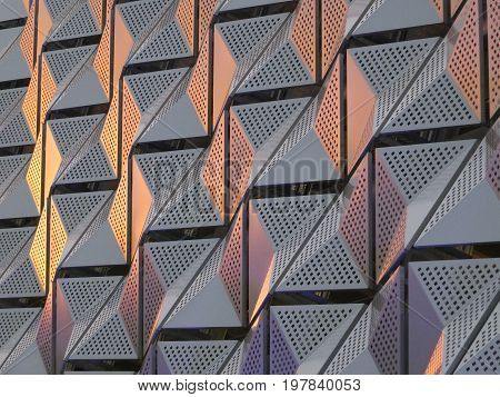 futuristic metallic triangular metal cladding with geometric modern pattern