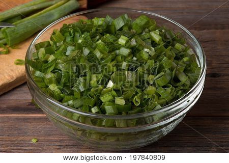 Sliced green onions. Finely chopped green onions in a plate