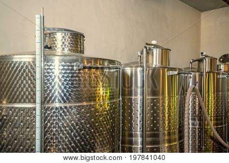 Modern winery plant with fermentaion stainless tanks for wine production