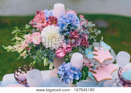 Wedding decoration in the style of boho floral arrangement decorated table in the garden. Bridal bouquet. Close-up
