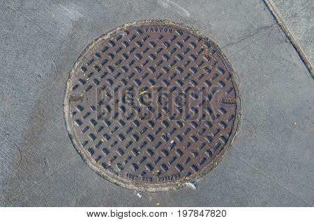 Gold Coast Australia - July 12 2017: manhole cover bearing the acronym of the Gold Coast City Council.