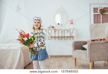 Happy girl with flowers in their hands.