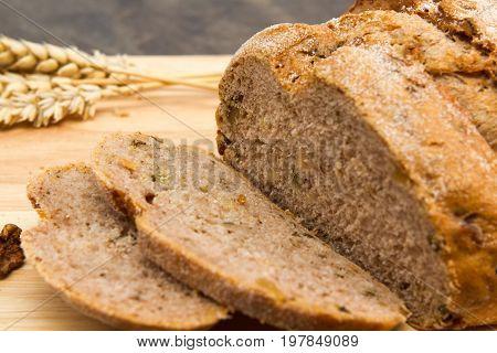 Walnut bread Walnut made bread with walnuts on a wooden board