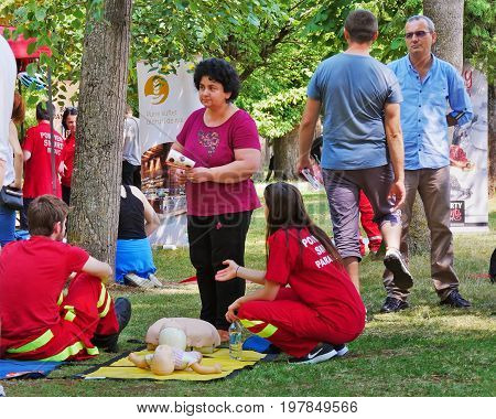 Paramedics are teaching people how to perform CPR on manikins in the park in Cluj-Napoca Romania - June 9 2017