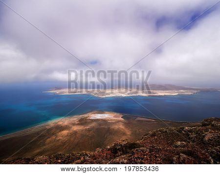 Impressive view from Mirador del Rio to island of La Graciosa Lanzarote Canary islands