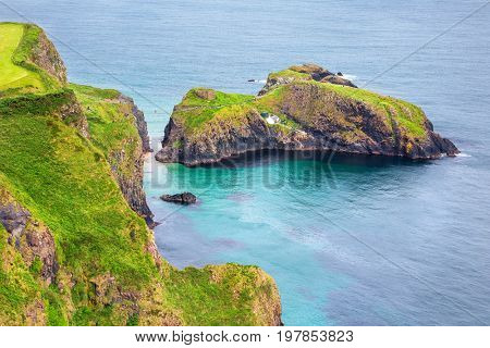 Aerial view of the Carrick-a-Rede Rope bridge, which links mainland and island of Carrickarede, Ballintoy, Northern Ireland, UK