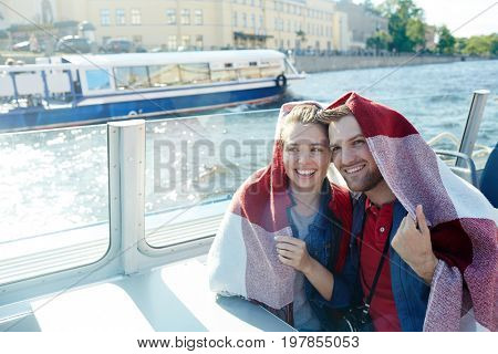 Couple in plaid floating in steamship on summer day