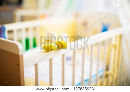 Children  shoes in a cot