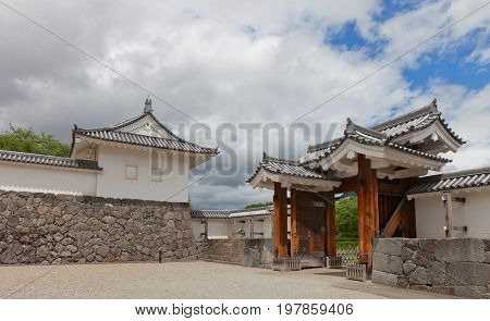 YAMAGATA JAPAN - MAY 28 2017: Reconstructed (1991) Outer Eastern Main Gate and Tamon Turret of Second Bailey of Yamagata Castle (founded in 1356). National historical site of Japan since 1986