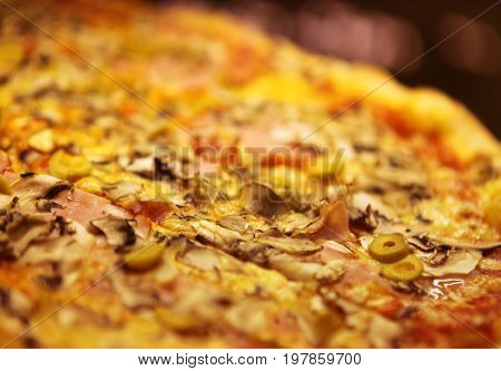 close up of tasty pizza with olives