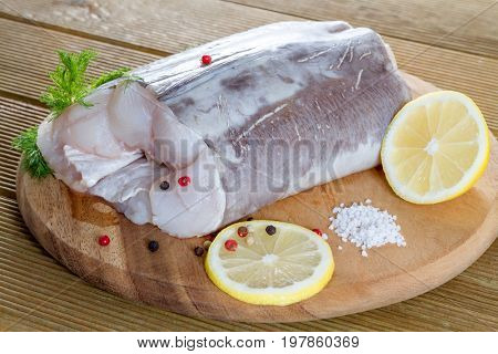 Raw catfish fillet with spices