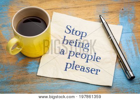 Stop being a people pleaser - handwriting on a napkin with a cup of espresso coffee