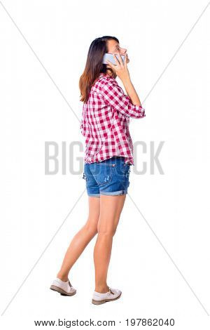back view of a woman talking on phone.  backside view of person. Rear view people collection. Isolated over white background. Girl in red shirt