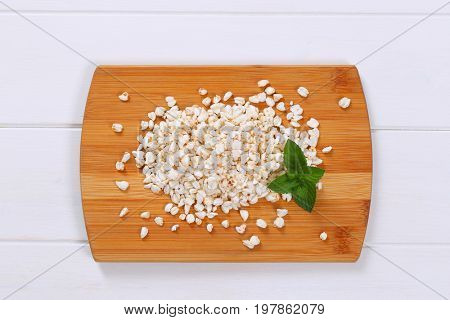 pile of puffed buckwheat on wooden cutting board