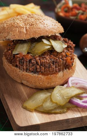 Ground beef burger sandwich with pickles and french fries