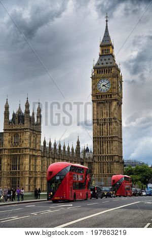 LONDON, UK - MAY 29, 2017:  Red buses in front of Big Ben, nickname of the Great Bell of the clock at the north end of the Palace of Westminster in London