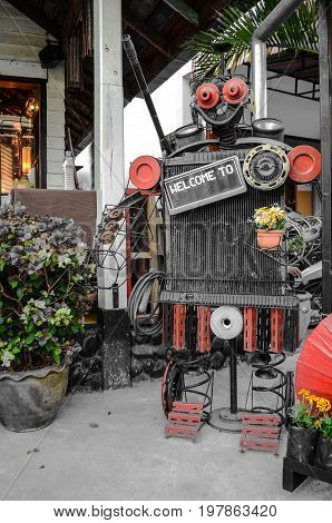 display metal robot vintage with welcome backboard