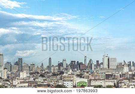 Bangkok cityscape Many building and construction. The top of view on skyscraper. Urban life background aerial shot of urban metropolis scenery with blue sky. Business building background.