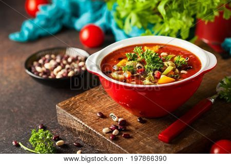 White and red bean soup with vegetables and tomatoes. Vegetarian bean soup for fall and winter season