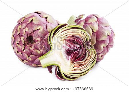 Whole and sliced fresh uncooked artichokes isolated on white background.