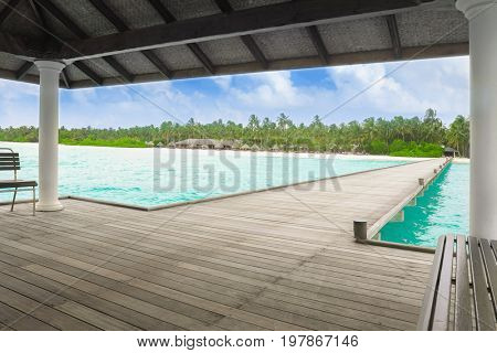 Shelter shed and wooden pontoon at sea resort on summer day