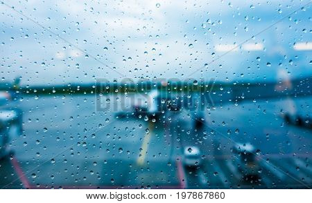 View from the airplane window in rainy non-flying weather rain