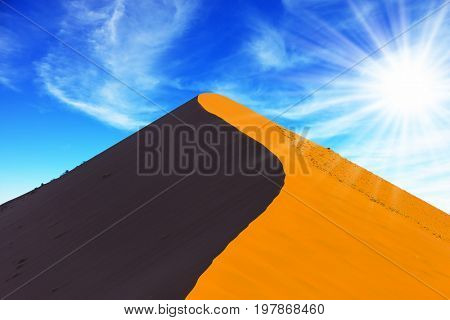 Namibia, South Africa, sunset. Hot sun of the Namib desert. Orange and  purple dune. The concept of extreme and exotic tourism