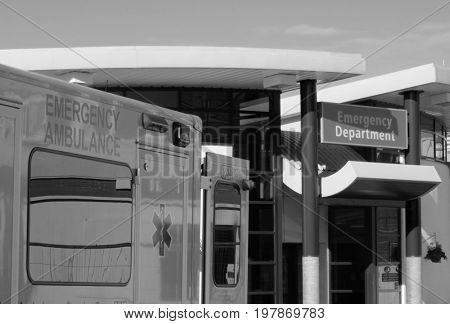 Ambulance vehicle parked outside of hospital emergency department