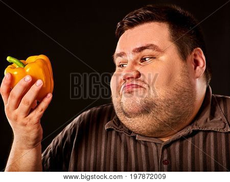 Diet fat man eating healthy food. Health breakfast with vegetables cauliflower and sweet pepper with radish for overweight person. Caricature of a fat man. He is trying to go on a diet.
