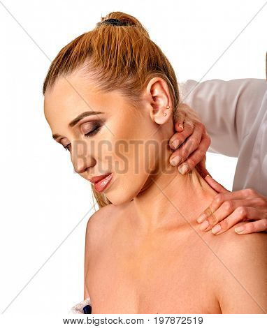 Shoulder and neck massage for woman in spa salon. Doctor making neck therapy in rehabilitation center on isolated. Correction of dislocation of the neck.
