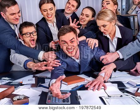 Business people office. Team people are unhappy with their leader. Intern man manager does not cope with his duties. Crowd in stress throw up their chief's papers. New employee is recruited.