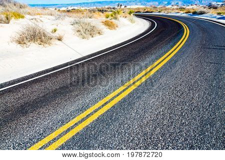 Yellow stripes on asphalt road